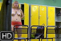 chuby lady getting naked in the locker room
