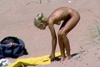 gorgeous blonde milf gets nude on the beach